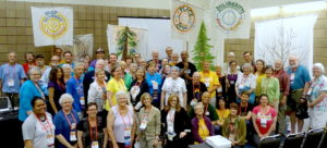 Participants in the UU Climate Justice Collaboratory gather & smile together for a photo