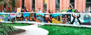 GROW Climate Justice participants holding a training banner