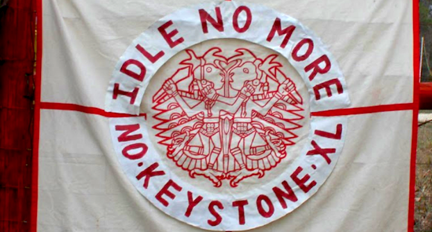 Banner with an Indigenous design that says Idle No More / No Keystone XL