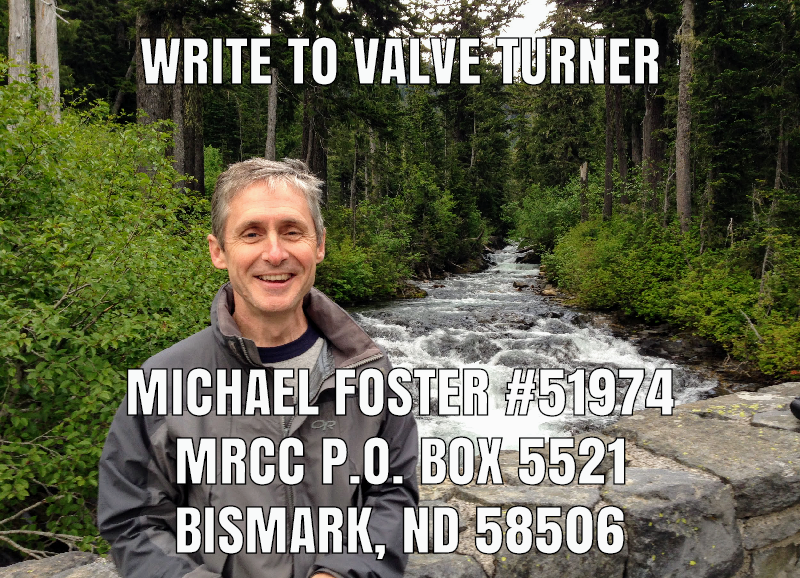 "A picture of Michael Foster smiling with a forest and stream in the background, with the following words transposed on top: ""Write to Valve Turner Michael Foster #51974, MRCC P.O. Box 5521 Bismark, ND 58506"