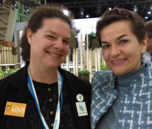 Doris Marlin (left) posing with Christina Figueres (right) former Executive Secretary of the UN Framework Convention on Climate Change