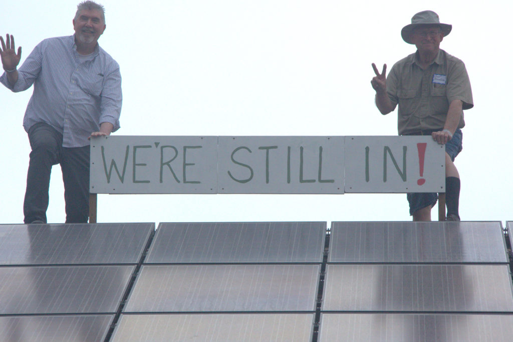 Unitarian Church of Lincoln Nebraska Green Sanctuary Committee Members boldly show their 96 Rooftop Solar Panels, (John Riley, Curt Donaldson), also members of Lincoln's Environmental Task Force for We Are Still In (Photographer Linda R. Brown)