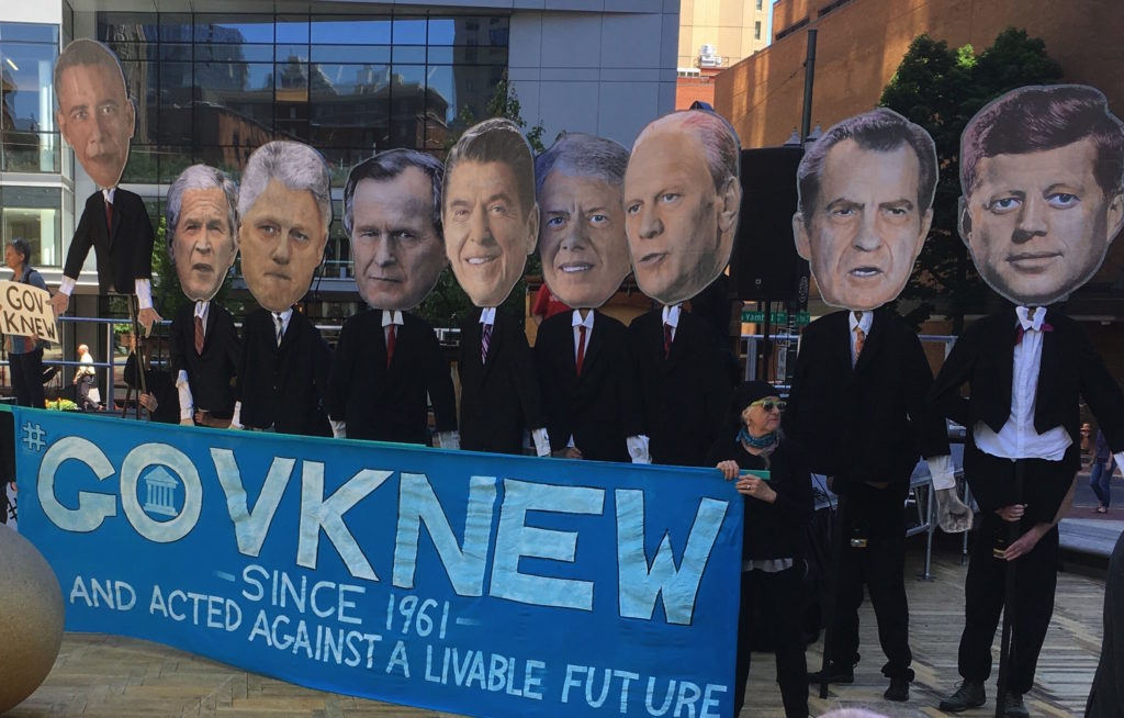 Photo of the street theater puppets depicting the last 9 presidents, used for a street theater piece presented by 350.org activists